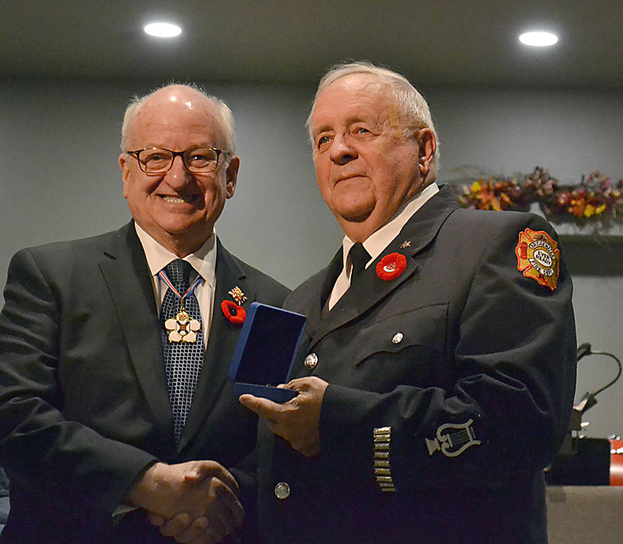 <p>Nova Scotia&#8217;s lieutenant governor, the Honourable Arthur LeBlanc, presents a Sovereign Medal to trombone player Gerry Holmes, who has served with the Bridgewater Fire Department&#8217;s Band for 49 years.</p>