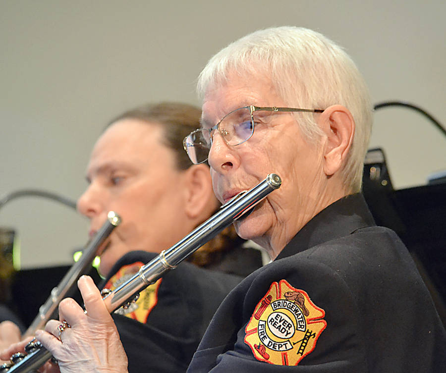 <p>Flute player Pat Slauenwhite (in the foreground) has been with the band for 26 years.</p>