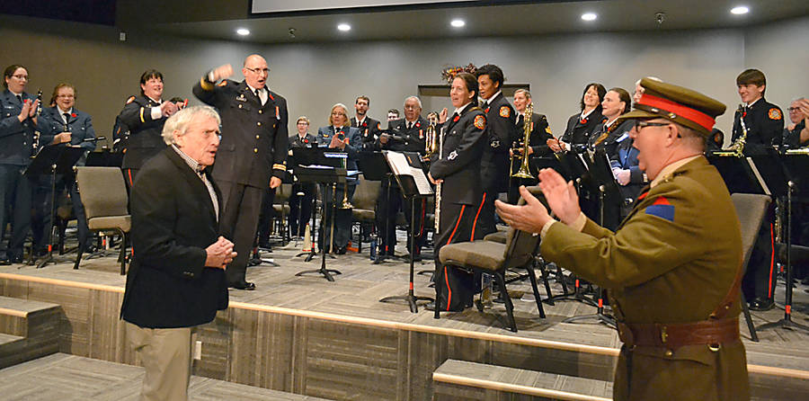 <p>GAYLE WILSON PHOTO</p><p>Local author and former band member John Cunningham (front left), who wrote the narrations and helped put the evening together, earned a round of applause from the master of ceremonies, Honourary Colonel Dan Hennessey, members of the band and the audience.</p>