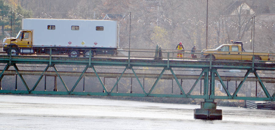 <p>KEITH CORCORAN, PHOTO</p><p>Work crews deal with repairs to the two-lane old bridge in Bridgewater. The structure, spanning the LaHave River, was expected to be back open to traffic November 16 but necessary additional work delayed the reopening.</p>