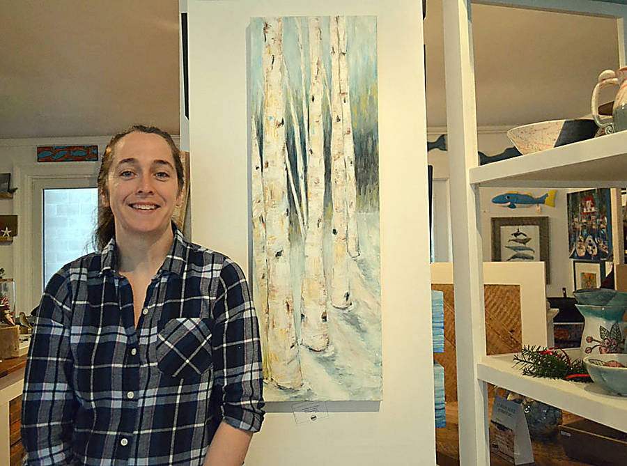 <p>GAYLE WILSON PHOTO</p><p>Robyn Howell in front of one of her paintings at her store, Going Coastal, in Chester.</p>