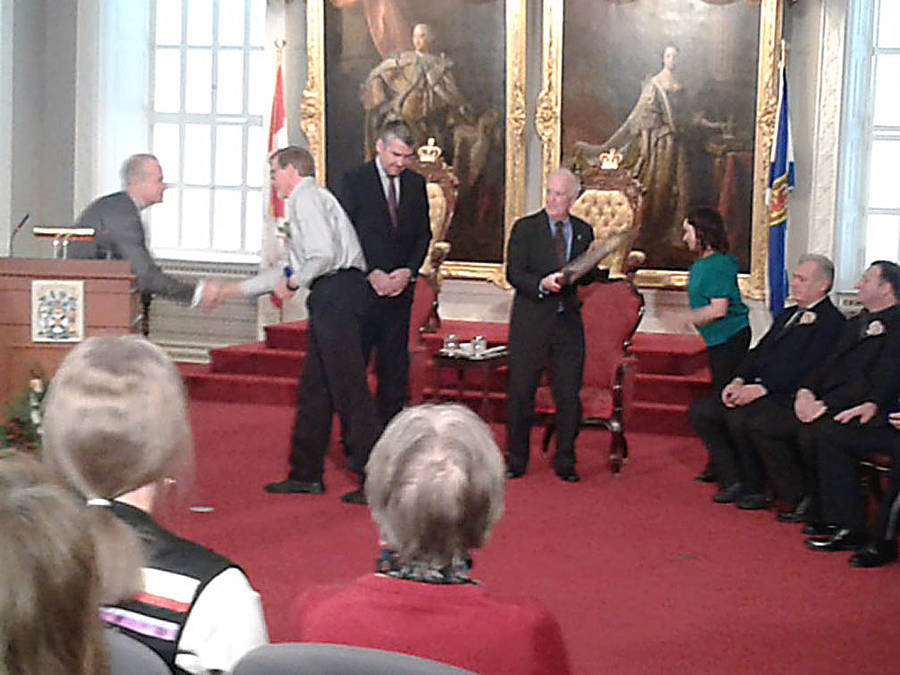 <p>CONTRIBUTED PHOTO</p><p>Paul Rowe receives a Medal of Bravery at Province House December 4.</p>
