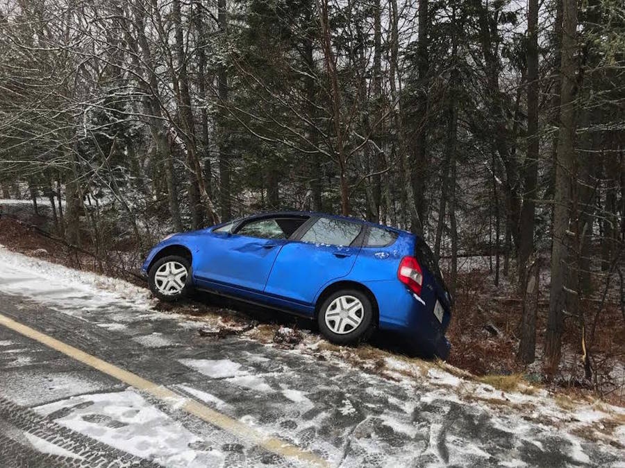 <p>Charles Mandel, photo</p><p>A Honda Fit rolled into the ditch after sliding off the road.</p>