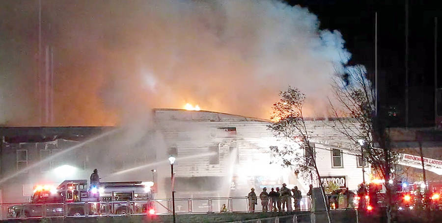 <p>KEITH CORCORAN, PHOTO</p><p>Volunteer firefighters battle the King Street blaze in Bridgewater, which started on October 22, 2017.</p>