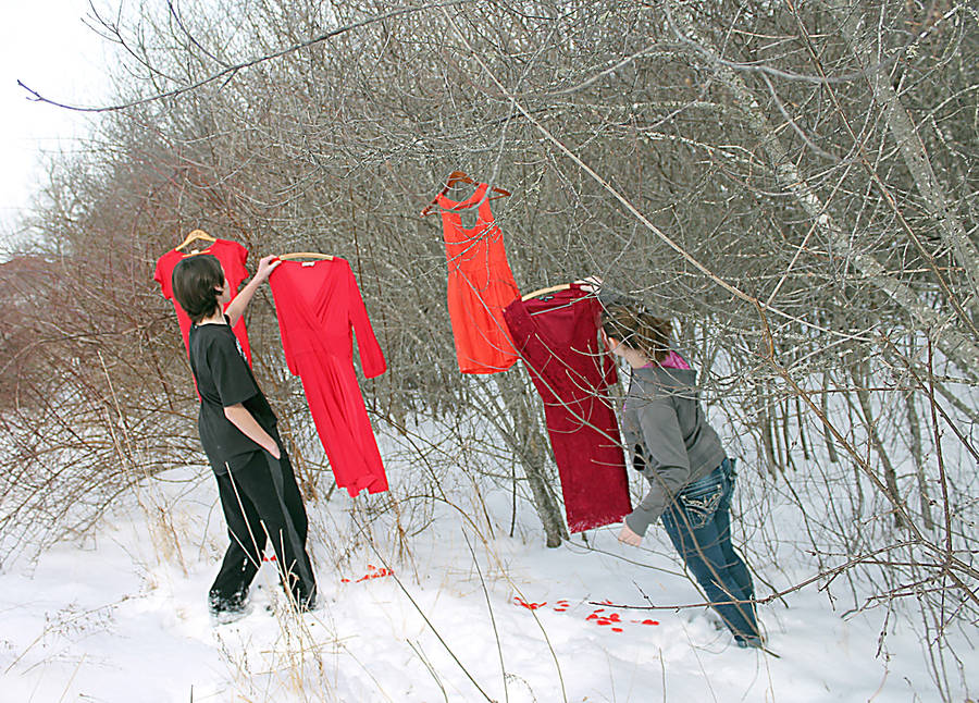 <p>CONTRIBUTED PHOTO</p><p>Ira Reinhart-Smith (left) and Gracie Reeves prepare for the Red Dress events organized by the North Queens Community School, which is looking to draw attention to the high proportion of missing and murdered Indigenous women.</p>