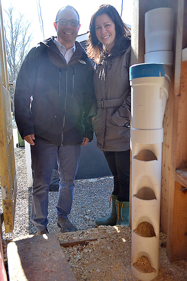 <p>GAYLE WILSON PHOTO</p><p>Scott Rawding, principal, and Kristy Boutilier, a guidance teacher at Petite Riviere Elementary School, with the automated chicken feeder developed by students Devin Helmer and Theryn Boutilier</p>
