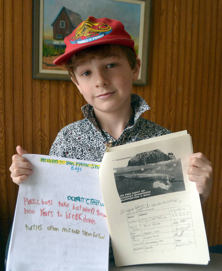 <p>KEITH CORCORAN, PHOTO</p><p>Neco Steele with copies of the petition and cover note. The nine year old presented the information April 8 to civic politicians in Bridgewater.</p>