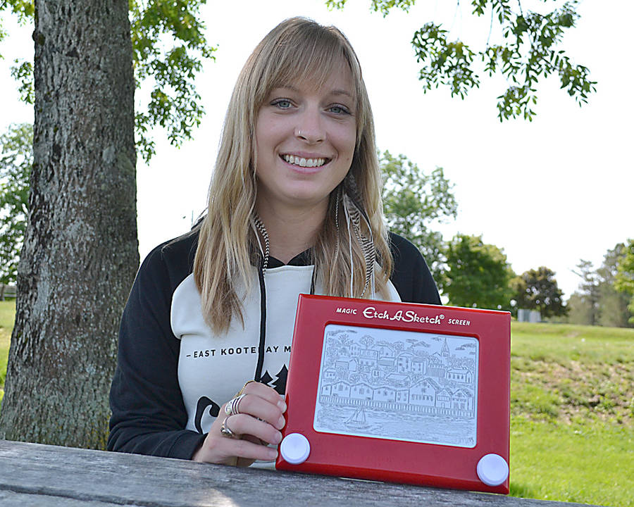 <p>GAYLE WILSON PHOTO</p><p>Megs Murray shows off her latest Etch A Sketch drawing &#8212; the Lunenburg waterfront.</p>
