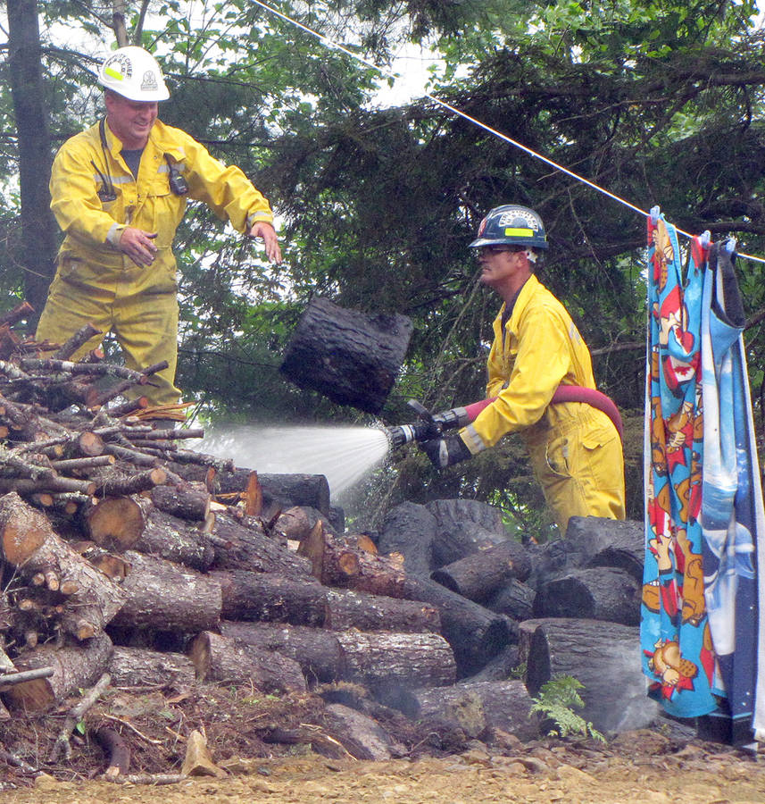 <p>KEITH CORCORAN, PHOTO</p><p>Emergency crews deal with a woods fire incident August 7 in Clearland.</p>