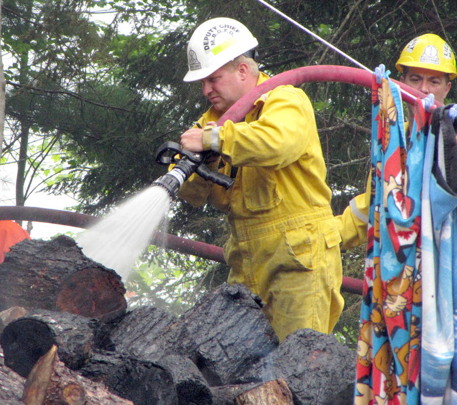 <p>KEITH CORCORAN, PHOTO</p><p>Volunteer firefighters work the August 7 scene of a woods fire in Clearland, near Mahone Bay.</p>