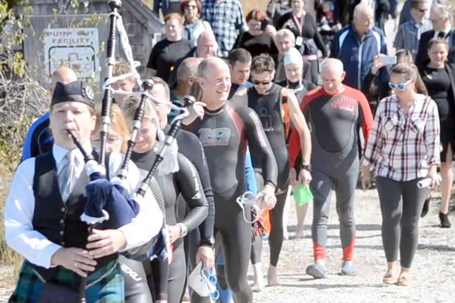 <p>KEITH CORCORAN, PHOTO</p><p>Swim participants make their way to the dock in Chester.</p>