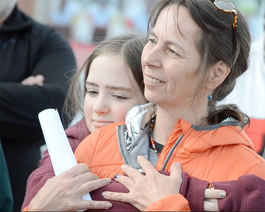 <p>KEITH CORCORAN, PHOTO</p><p>Fiona Steele, right, and cancer survivor Hailey Rodenhiser share a moment in Lunenburg on September 20.</p>