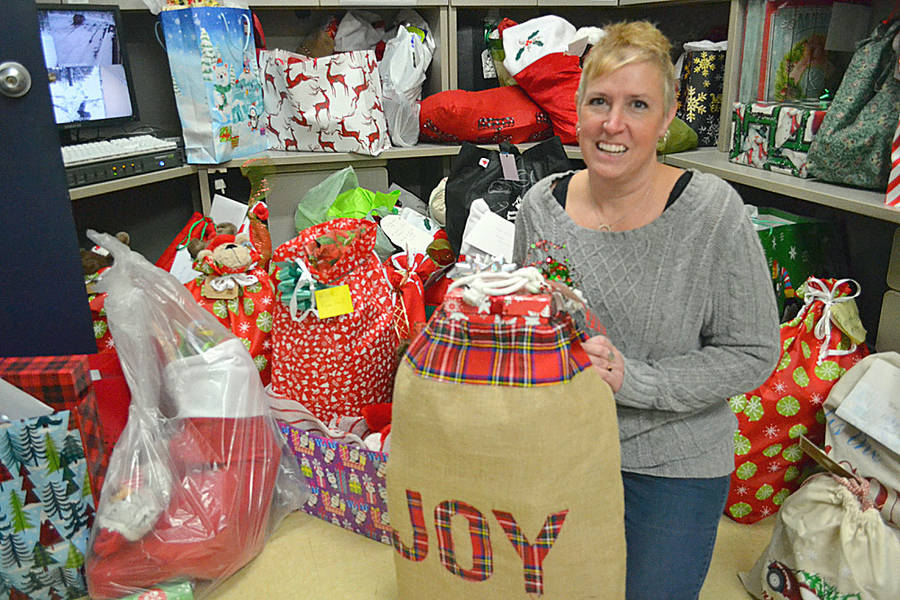 <p>Shannon Stewart of West Northfield leads a community of volunteers who donated presents to 228 seniors in the area.</p>