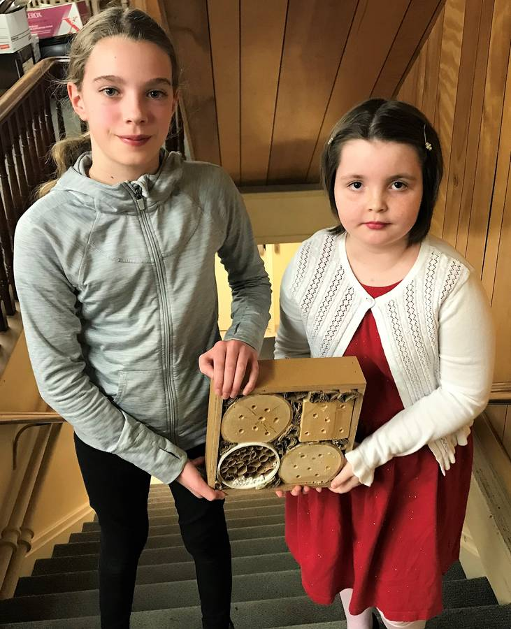 <p>KEVIN MCBAIN PHOTO</p><p>Maeva Brisson (left) and Sadie David, members of the <em>FIRST </em>Lego League team at Centre Scolaire de la Rive Sud, encouraged the Town of Mahone Bay Mayor and Council to start a Pollinator Action program to help save the bees.</p>