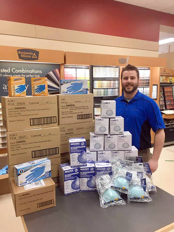 <p>FACEBOOK/CHESTER BUILDING SUPPLIES</p><p>Chester Building Supplies assistant manager Ashley Bushen with the selection of masks and gloves that were recently delivered to South Shore Regional Hospital in Bridgewater.</p>