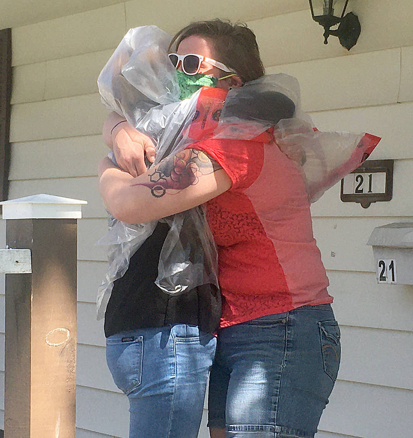 <p>CONTRIBUTED PHOTO</p><p>Lisa Green (left) hugs her daughter Samantha for the first time since the pandemic began.</p>
