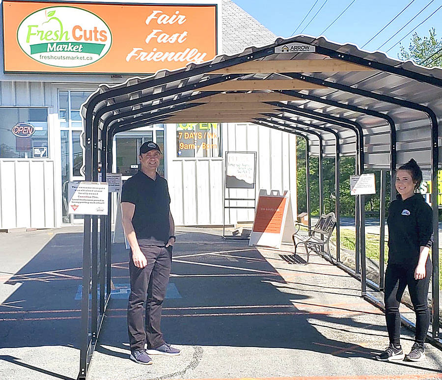 "<p>CONTRIBUTED PHOTO</p><p style=""text-align:right;"">Andrew Langille, Fresh Cuts Market co-owner and operator, and Keshia Daniels, assistant manager, stand under the store&#8217;s weather structure.</p>"