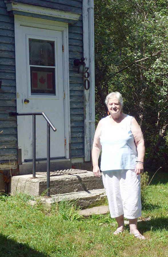 <p>CONTRIBUTED PHOTO</p><p>Kat Wright in front of her Voglers Cove home where she can now stay.</p>