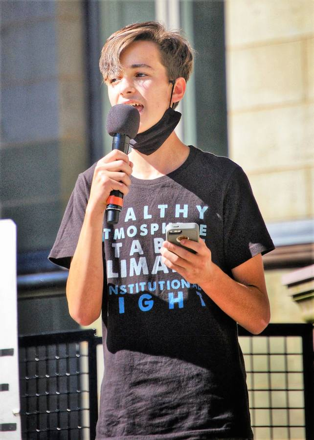 <p>PHOTO BY MAREN MEALEY</p><p>Ira Reinhart-Smith, 16, of Caledonia talks to a crowd during a climate march in Halifax earlier this year. The young activist is one of 15 Canadian youths taking on the federal government in a lawsuit over climate change.</p>