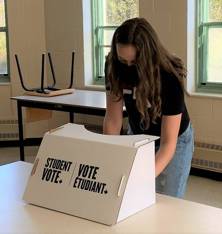<p>CONTRIBUTED PHOTO</p><p>Liverpool Regional High School student Ava Smith casts her vote during a mock municipal election for the students at the school October 15.</p>