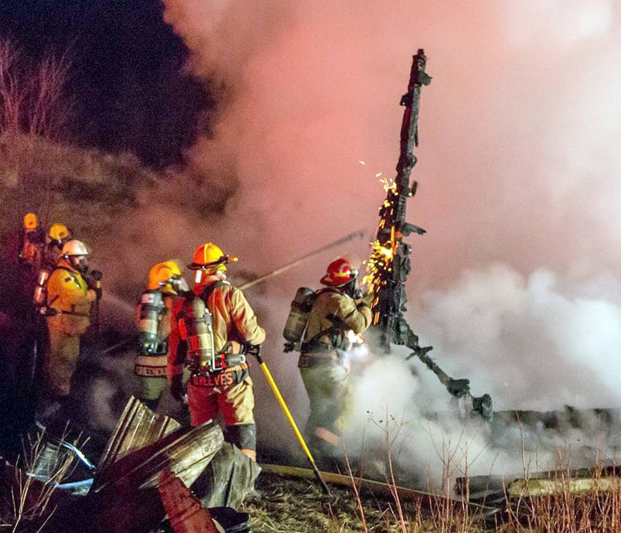 <p>BRIAN TAYLOR, PHOTO</p><p>Emergency crews work the scene of a house fire in Aldersville, north of New Ross.</p>