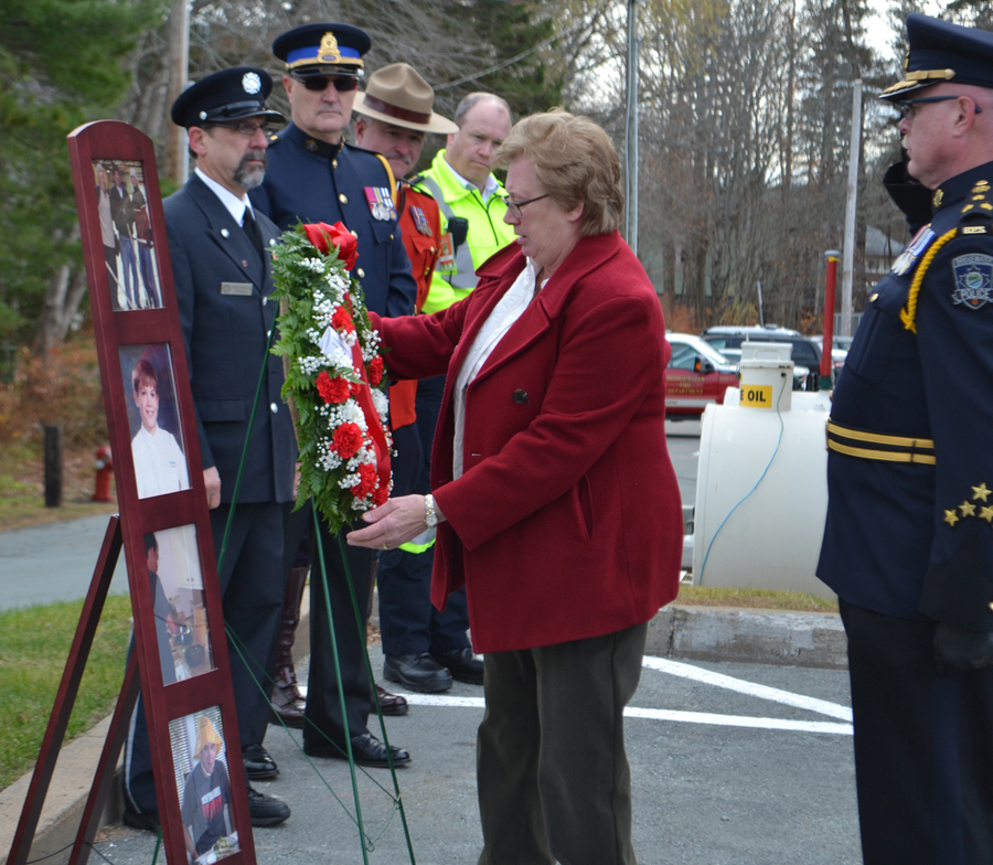 <p>EVAN BOWER PHOTO</p><p>Ida Scott lays a wreath by a memorial for her son Paul, who died when he collided head-on with a transport truck on his way home from a concert in 2004.</p>