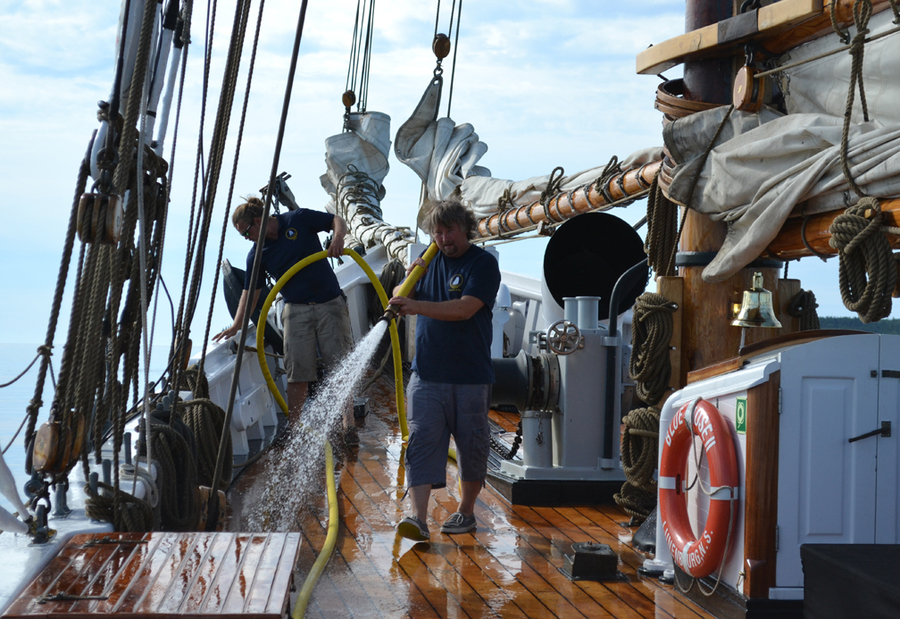 <p>EMMA SMITH photo</p><p>Deckhand participant Karl Loenhart helps wash the deck at the start of the day. He says even with the roughly $500 pricetag, he'd do it again.</p>