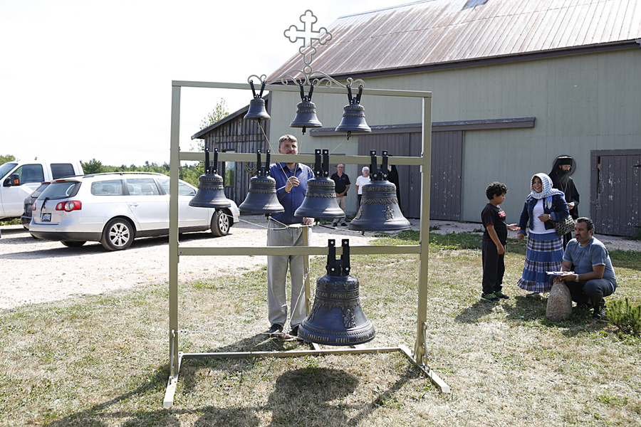 <p>BRITTANY WENTZELL PHOTO</p><p>Andrei Diachkov, a master bell ringer from Russia, does a demonstration on the new bells.</p>