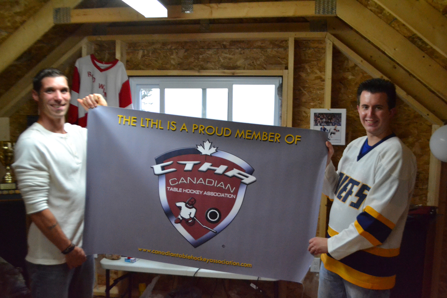 <p>EVAN BOWER PHOTO</p><p>From left, participant Shane Weaver and founder Cody Nodding announce the Lunenburg Tabletop Hockey League has joined a group of 16 other leagues across the country on September 6.</p>