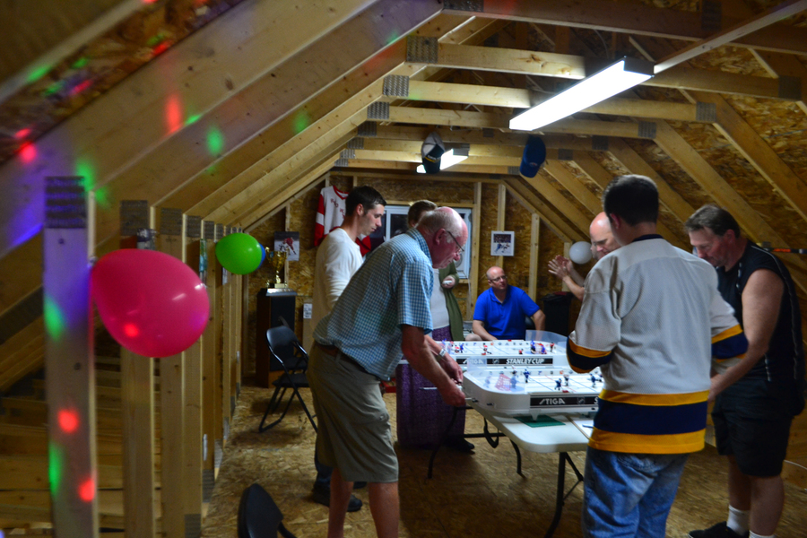 <p>EVAN BOWER PHOTO</p><p>Players in the Lunenburg Tabletop Hockey League meet every Tuesday in Cody Nodding's garage.</p>