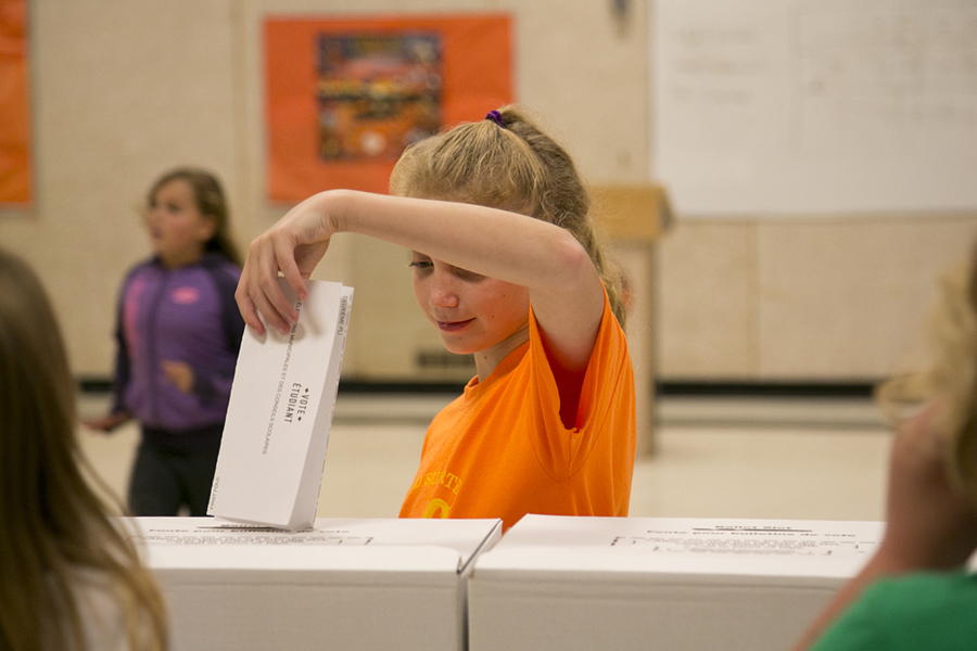 <p>BRITTANY WENTZELL PHOTOS</p><p>Raeann Young casts her vote at a mock election at Newcombville Elementary on October 13.</p>