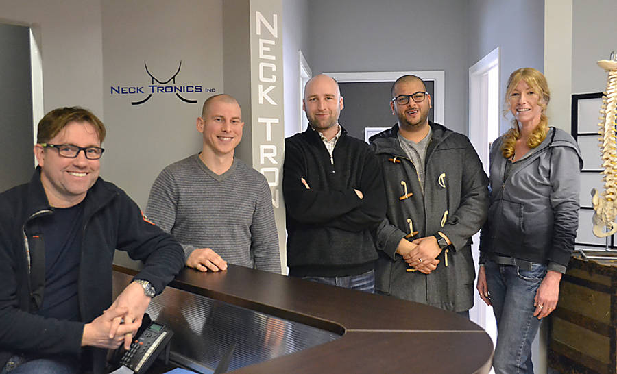 <p>GAYLE WILSON PHOTO</p><p>Neck Tronics founder Bill Smith (far left) and his team of engineers and technicians: Lee Babin, Jonathan Kaye, Hady Sarhan and Dyn'se Burton.</p>