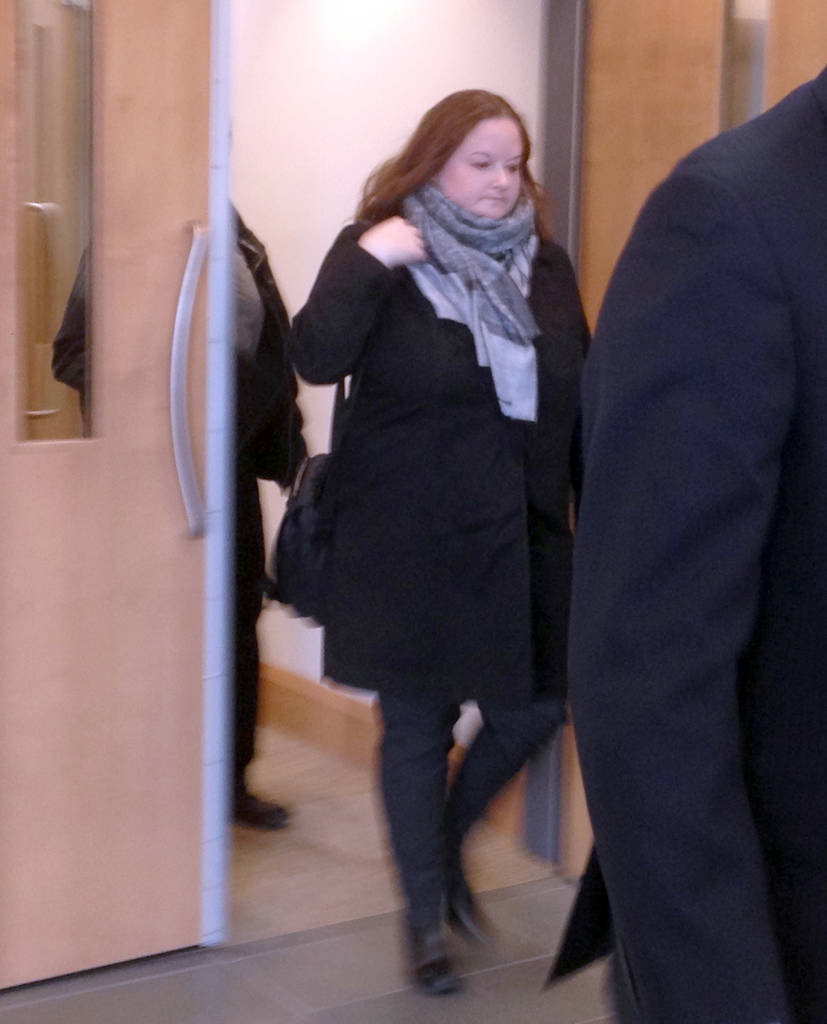 <p>FILE PHOTO</p><p>Dr. Sarah Dawn Jones exits a Bridgewater courtroom during the early stages of the trial.</p>