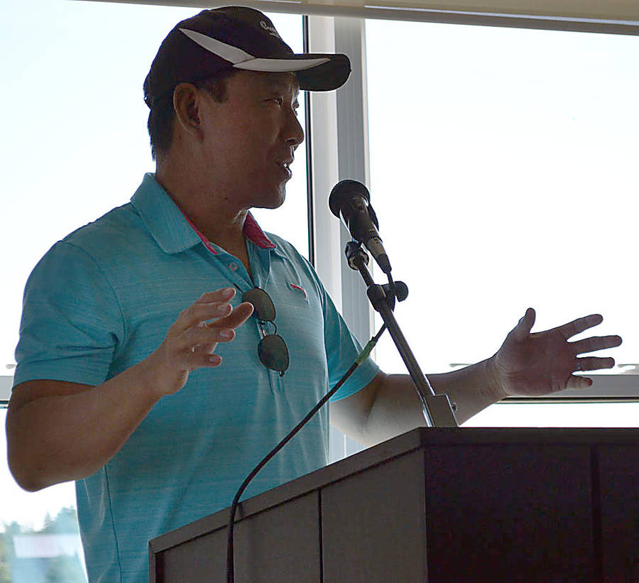 <p>GAYLE WILSON PHOTO</p><p>Dr. Chen Meng, a radiologist at the South Shore Regional Hospital in Bridgewater explains the advantages of a new mammography work station to golfers at the 19th annual Hit It For Health fundraiser at Osprey Ridge Golf Club on July 5.</p>