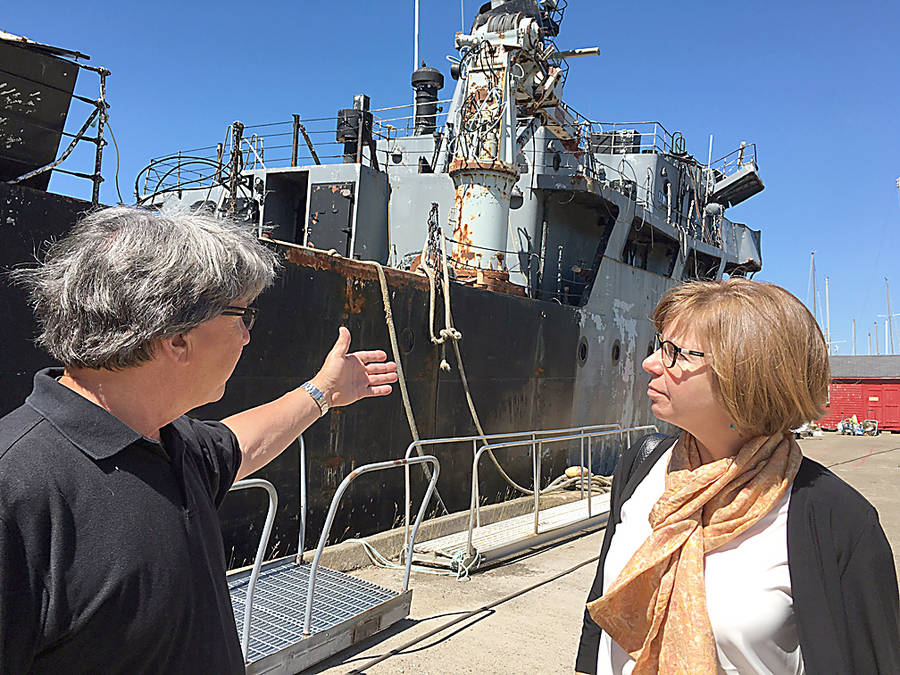 <p>CONTRIBUTED PHOTO</p><p>Frank Bemben, manager of the Bridgewater Marina, discusses the abandoned vessel, the Cormorant, which has been an eyesore in the marina area for years, with Sheila Malcolmson, NDP MP for Nanaimo-Ladysmith, B.C.</p>