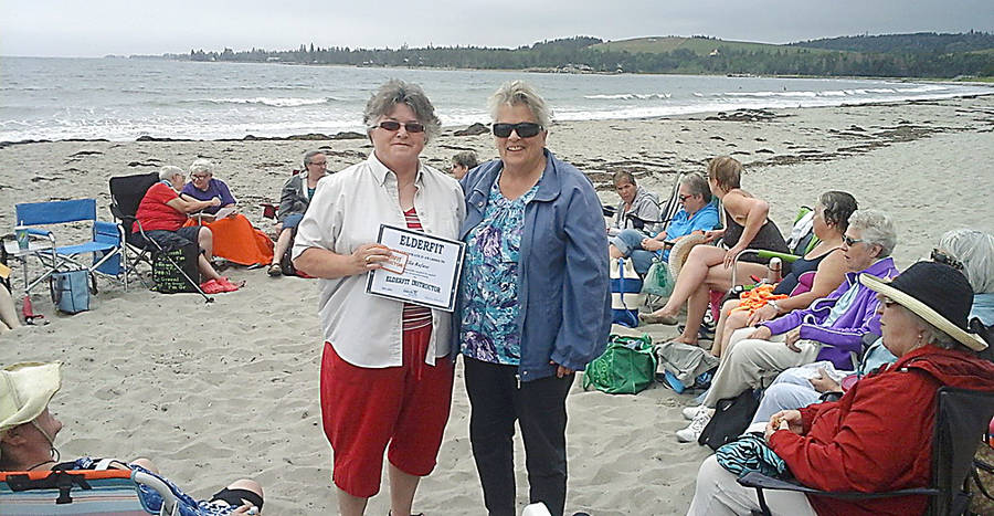 <p>CONTRIBUTED PHOTO</p><p>Martha Saunders (right) takes time out at the Elderfit group's beach event to present volunteer Ella Rafuse with her instructor certificate.</p>