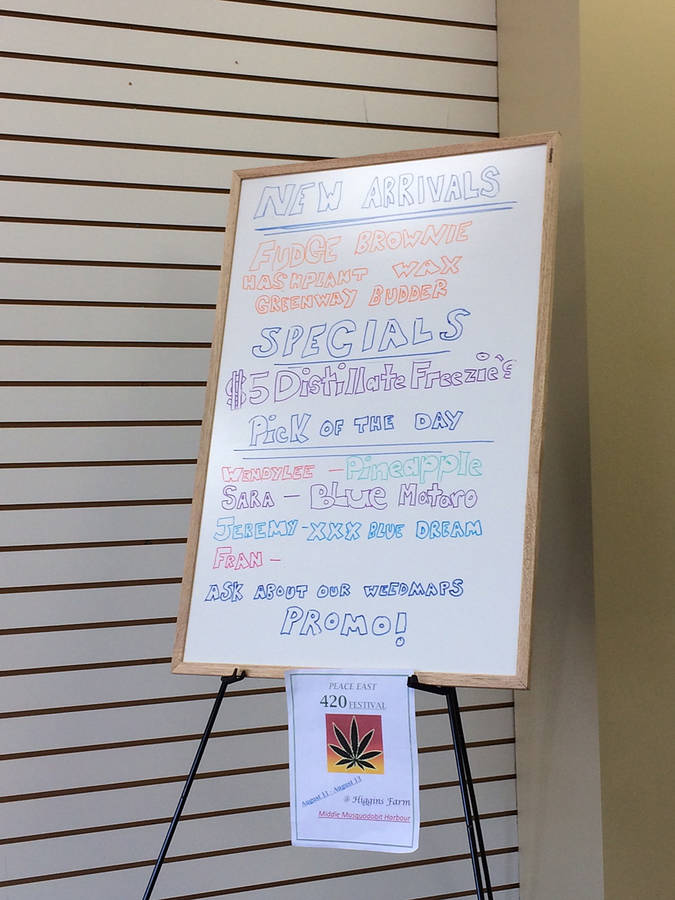 <p>BRITTANY WENTZELL PHOTO</p><p>A white board in the dispensary advertising specials and deals at the facility.</p>