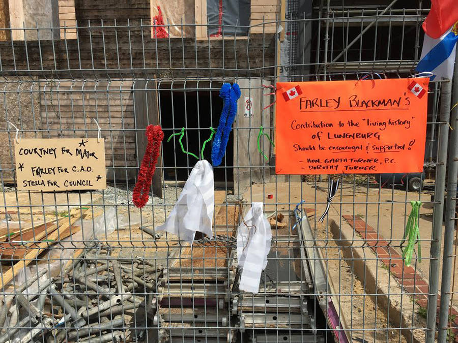 <p>Gayle Wilson photo</p><p>A construction fence in Lunenburg shows messages of support for Farley Blackman.</p>