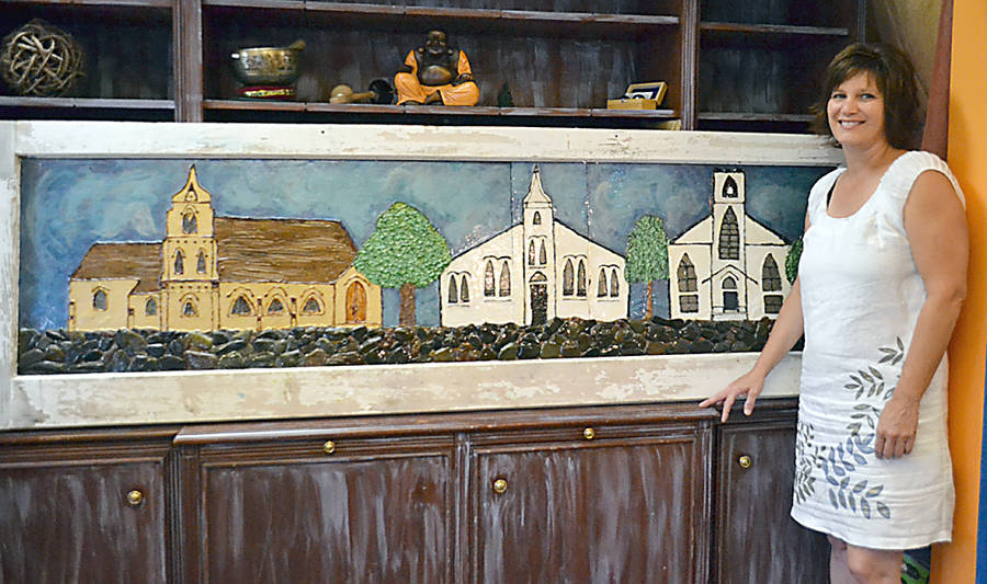 <p>GAYLE WILSON PHOTO</p><p>Tamara Whynott, artist and owner of the Awakened Healing Shop in Mahone Bay, has vowed to contribute half of the proceeds she makes from every glass painting of the three churches she sells, less the cost of materials, to the Three Churches Foundation.</p>