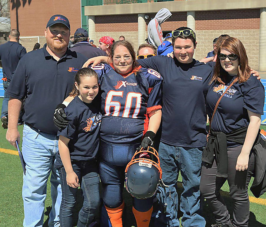 <p>MARK KAYS PHOTO</p><p>The Dickens family members all play or coach football — parents James and Samantha (Sam) Dickens, and their children (left to right) Mackenzie, Christian and Michaela.</p>