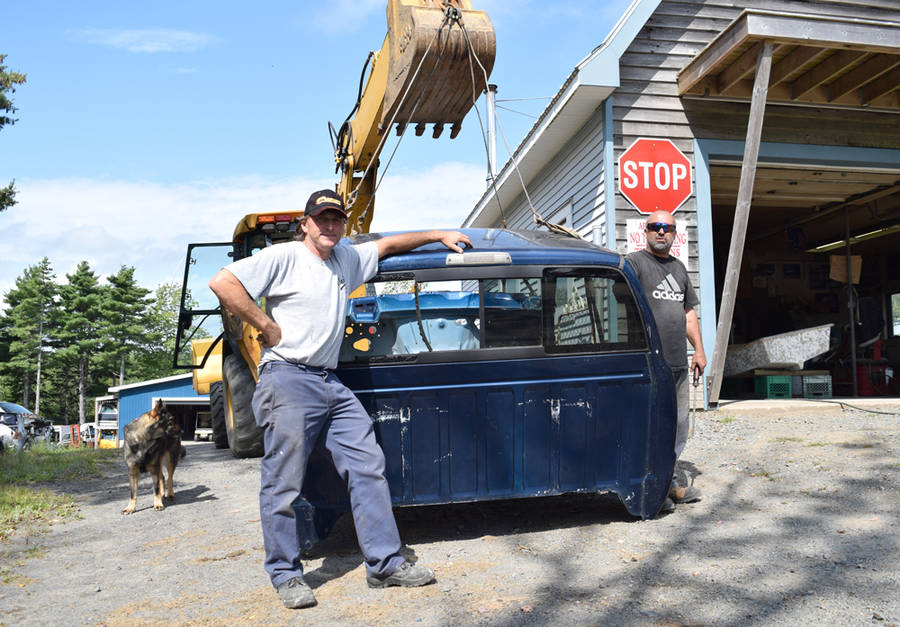 <p>MICHAEL LEE PHOTO</p><p>From left, Blair Moland and Kenny Heim. Moland said he has closed his garage seven times this year because of the smell coming from the nearby compost site.</p>