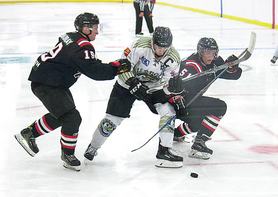 <p>NICK MOASE PHOTO</p><p>Colts players Liam Kilmurray, left, and Keith Leadbeater, right, crash into Privateers Captain Brandon Pottie in an attempt to keep him away from the puck.</p>