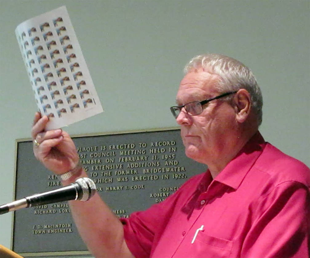 <p>KEITH CORCORAN PHOTO</p><p>Lloyd Tancock of the South Shore Stamp Club displays post marks to a September 25 meeting of Bridgewater town council. Pictorial postmarks depicting one of the town's newest parks will be publicly unveiled later this month during the club's annual fair.</p>