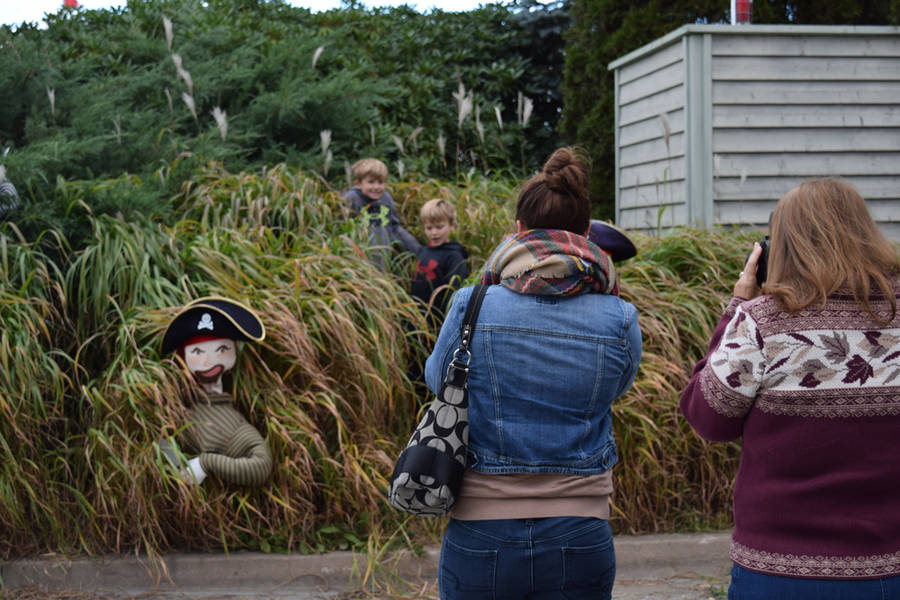 <p>From left, nine-year-old Aiden Worr and eight-year-old Carter Worr stand alongside some pirates in a patch of tall grass.</p>