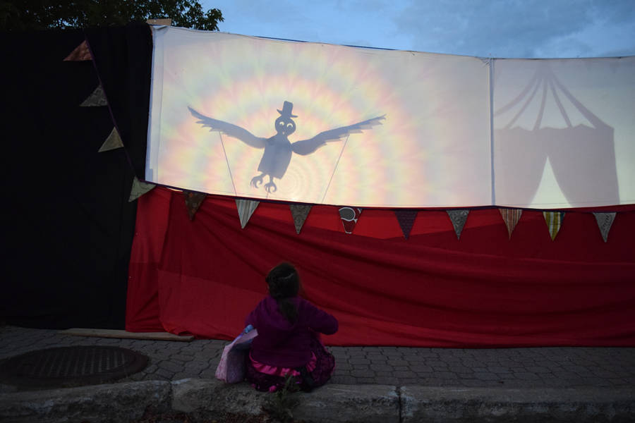<p>MICHAEL LEE PHOTO</p><p>A young girl watches a shadow puppet show.</p>