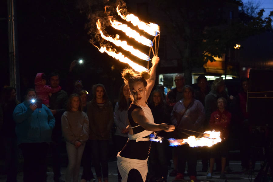 <p>MICHAEL LEE PHOTO</p><p>A fire dancer enchants an awestruck crowd.</p>