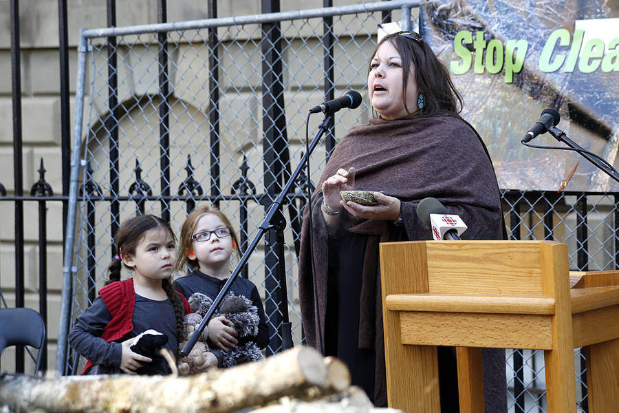 <p>BRITTANY WENTZELL PHOTO</p><p>Melissa Labrador and her twin children, Tepkunaset and Nakuset, perform a smudging ceremony in front of Province House.</p>