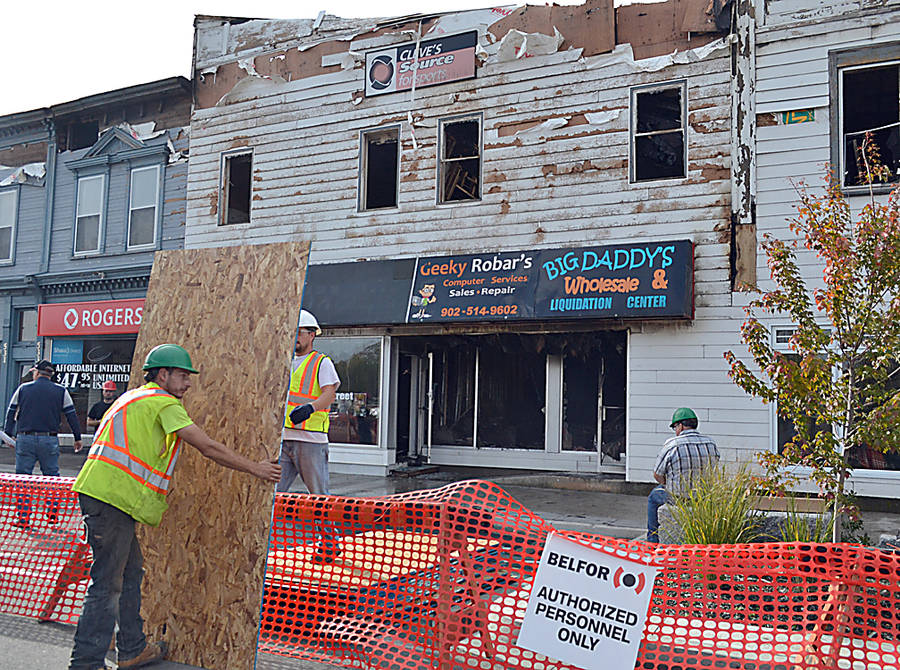 <p>GAYLE WILSON PHOTO</p><p>Workers begin preparing for the demolition of the King Street buildings destroyed by fire Sunday night. Demolition and clean up is expected to take three or four days</p>