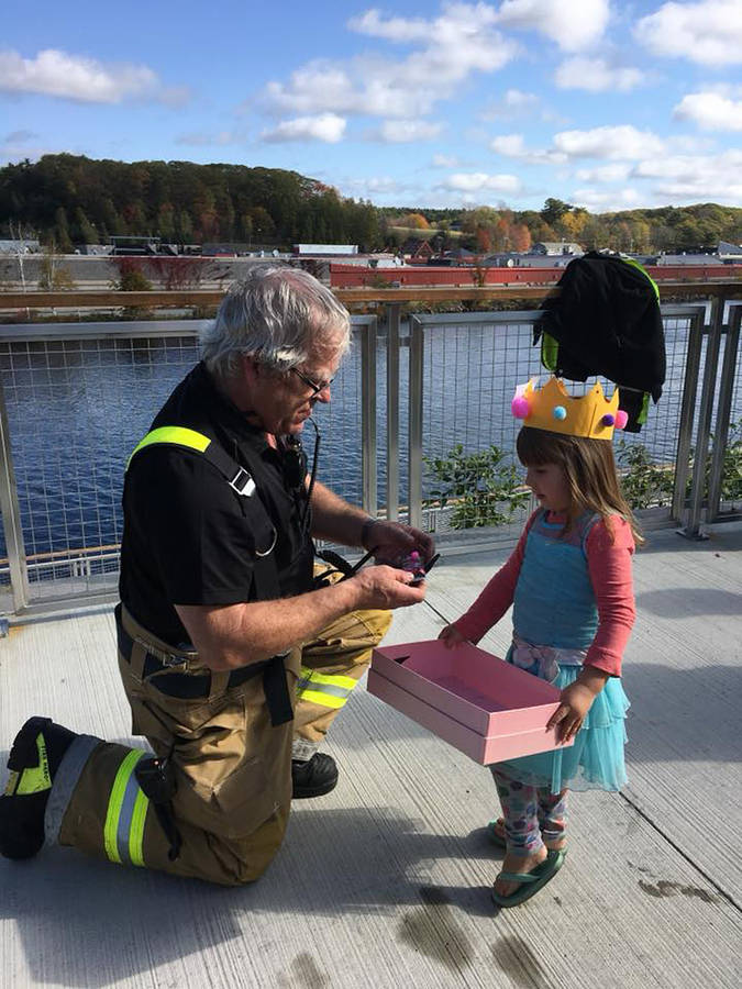 <p>PHOTO COURTESY DAVID MITCHELL</p><p>A little girl was spotted handing out cookies to firefighters the morning after the fire.</p>