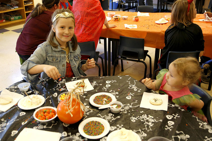 <p>Bella and Willow Mullen decorate some cookies. There were plenty of Wonder Woman costumes spotted throughout the day.</p>